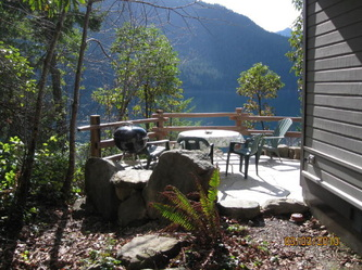 Lake Crescent Cabin patio view of Lake Crescent - lodging available year round inside Olympic National Park